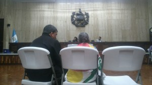A witness gives her testimony with the help of a translator. Photo: CMI Guatemala