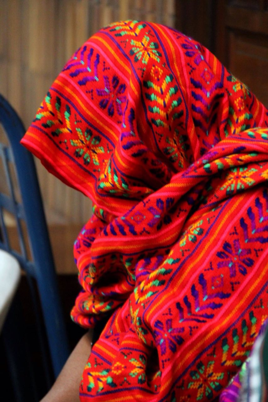 Women listen on with their faces covered to the testimonies presented to the court. Photo: CMI Guatemala