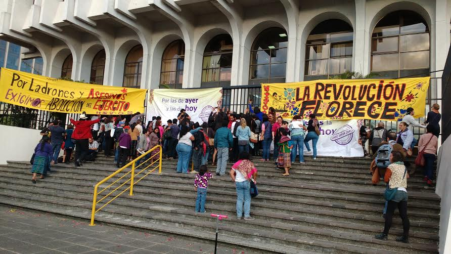 """""""The Revolution is Flowering"""" outside the courthouse following the guilty verdict."""
